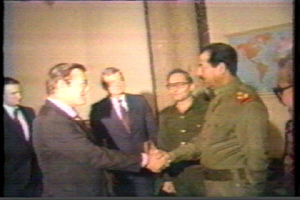 Reagan's man, the monster dumbass Donald Rumsfeld, shakes Satan's hand, 1983, when negotiating the importation of materials needed for poison gas production.